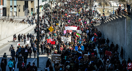 commotion: MONTREAL, CANADA, APRIL 02 2015. Riot in the Montreal Streets to counter the Economic Austerity Measures. Panoramic View (XXXL Resolution) of the Streets Packed with Protesters