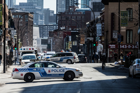 furor: MONTREAL, CANADA, APRIL 02 2015. Riot in the Montreal Streets to counter the Economic Austerity Measures.  Police Car in the Middle of the Street Blocking Traffic Editorial