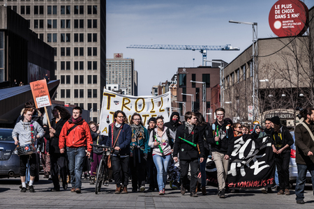 commotion: MONTREAL, CANADA, APRIL 02 2015. Riot in the Montreal Streets to counter the Economic Austerity Measures. View of the First line of Protesters walking in the Street