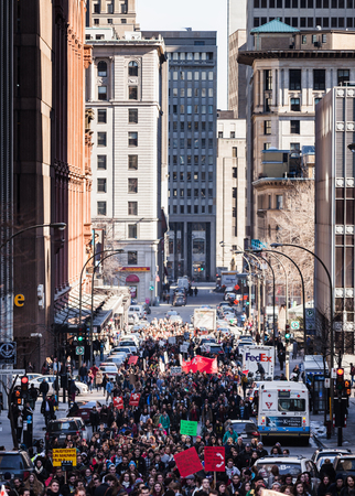 commotion: MONTREAL, CANADA, APRIL 02 2015. Riot in the Montreal Streets to counter the Economic Austerity Measures. People walking in the middle of the street.