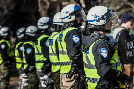 furor: MONTREAL, CANADA, APRIL 02 2015. Riot in the Montreal Streets to counter the Economic Austerity Measures. Closeup of Police Gear and Protections