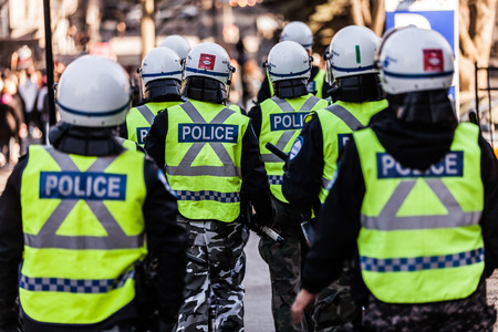 austerity: MONTREAL, CANADA, APRIL 02 2015. Riot in the Montreal Streets to counter the Economic Austerity Measures. Closeup of Police Gear and Protections