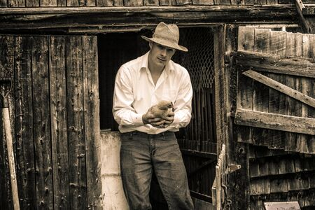 barn door: Young Farmer and a Chicken at the Farm