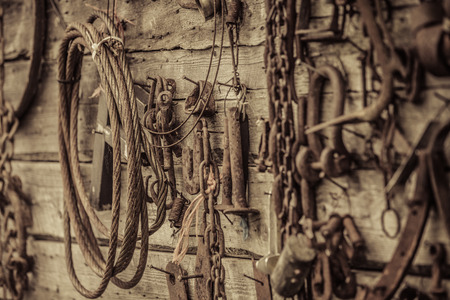 outbuilding: Wall Filled with Old Rusty Tools Hanging on the wall