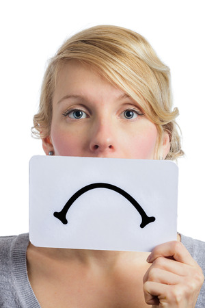 morose: Unhappy Portrait of a Woman Holding a Sad Mood Board Isolated on white Background