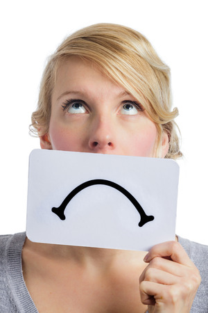 despairing: Unhappy Portrait of a Woman Holding a Sad Mood Board Isolated on white Background