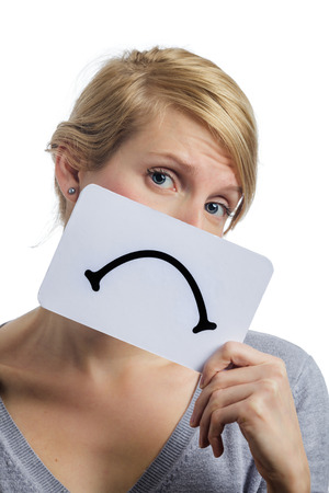 miserable: Unhappy Portrait of a Woman Holding a Sad Mood Board Isolated on white Background