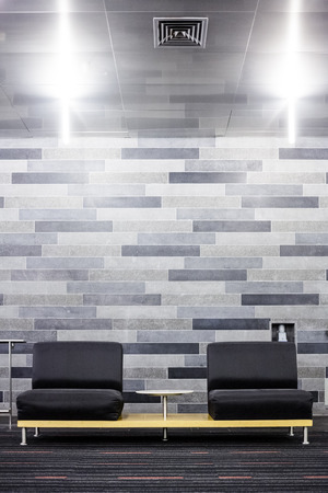 Very Modern Couch Setup in Front of a Gray Brick Wall