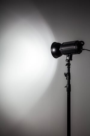 torchlight: White and Bright Shape Created on the Wall with Studio Light Flashes Stock Photo