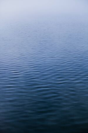 Very Calm Water texture on a Foggy Morning