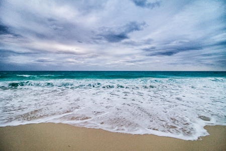 agitated: Agitated Sea and Waves and Bad Weather on the beach in Vacation Stock Photo