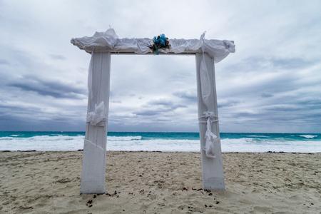 destination wedding: Wedding Arch on the Beach and Bad Weather