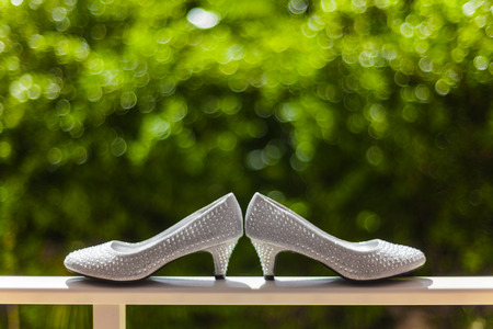 guard rail: Pair of Wedding Shoes on a Guard Rail Stock Photo