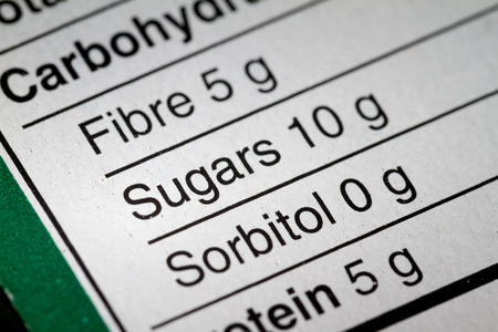 carbohydrates: Shallow depth of Field image of Nutrition Facts Carbohydrate Information we can find on a grocery Store Product.