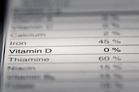 d data: Shallow depth of Field image of Nutrition Facts Vitamin D Information we can find on a grocery Store Product.