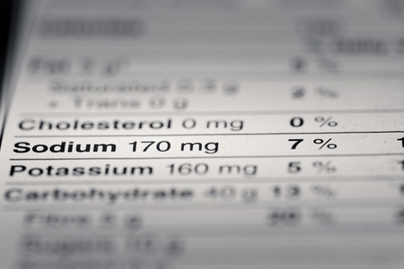 sodium: Shallow depth of Field image of Nutrition Facts Sodium Information we can find on a grocery Store Product.