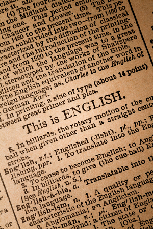 parlance: October 1st, 2015 - Montreal, Canada. Close-up of an Old 1945 Webster Vintage Dictionary showing a phrses about English Language