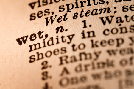dank: October 1st, 2015 - Montreal, Canada. Close-up of an Old 1945 Webster Vintage Dictionary showing the Word WET Editorial