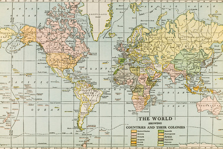 like english: October 7th, 2015 - Montreal, Canada. Old and Vintage 1945 English Webster Dictionary. World map like it was in the 1940s including U.R.S.S. and other differences.