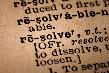 resolve: October 1st, 2015 - Montreal, Canada. Close-up of an Old 1945 Webster Vintage Dictionary showing the Word RESOLVE Editorial