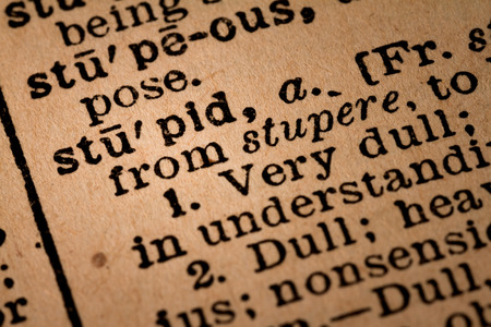 adjective: October 1st, 2015 - Montreal, Canada. Close-up of an Old 1945 Webster Vintage Dictionary showing the Word STUPID