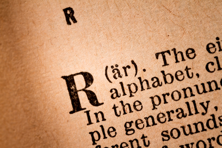 pronunciation: October 1st, 2015 - Montreal, Canada. Close-up of a R, the 18th Letter of the Latin Alphabet into a Old Pronunciation Dictionary