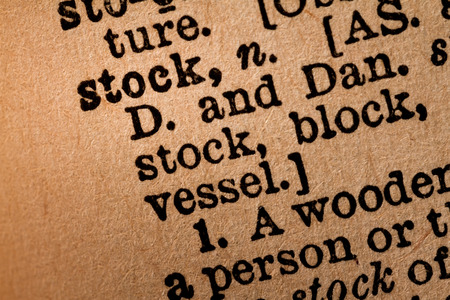 microstock: October 1st, 2015 - Montreal, Canada. Close-up of an Old 1945 Webster Vintage Dictionary showing the Word STOCK