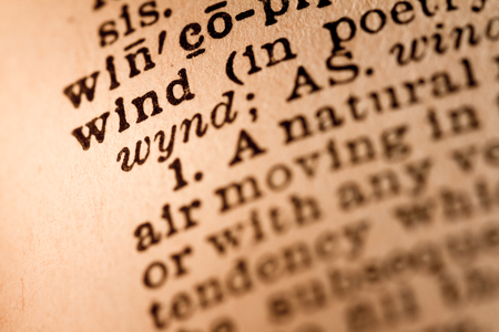 noun: October 1st, 2015 - Montreal, Canada. Close-up of an Old 1945 Webster Vintage Dictionary showing the Word WIND Editorial