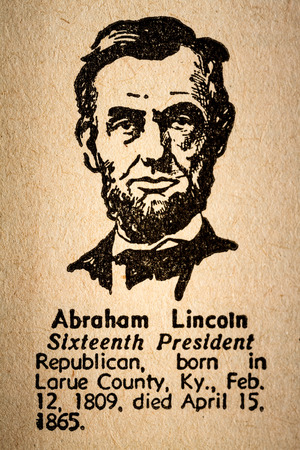 abraham lincoln: October 6th, 2015 - Montreal, Canada. Old 1945 Websters Dictionary Macro Close-up of Abraham Lincoln the 16th President of the United State of America Drawing and little historical text.