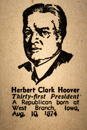 31st: October 6th, 2015 - Montreal, Canada. Old 1945 Websters Dictionary Macro Close-up of Herbert Hoover the 31st President of the United State of America Drawing and little historical text.