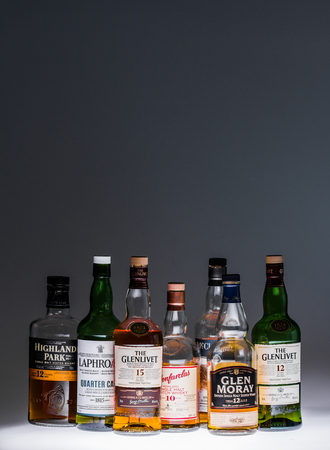 10 to 12 years old: October 1st - Montreal, Canada. Collection of a few Good and Popular Single Malt Scotch Bottles in studio.