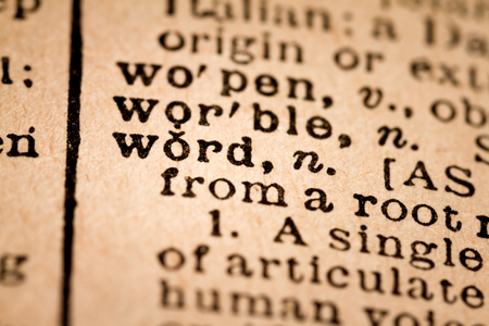 utterance: October 1st, 2015 - Montreal, Canada. Close-up of an Old 1945 Webster Vintage Dictionary showing the Word WORD