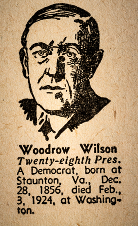 wilson: October 6th, 2015 - Montreal, Canada. Old 1945 Websters Dictionary Macro Close-up of Woodrow Wilson the 28th President of the United State of America Drawing and little historical text.
