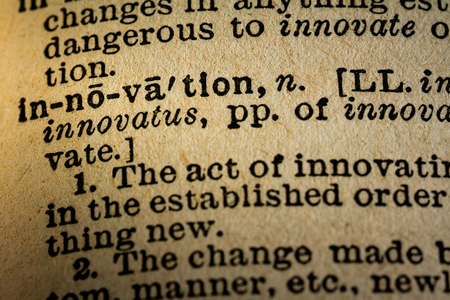 October 6th, 2015 - Montreal, Canada. Old 1945 Websters Dictionary Macro Close-up of the word INNOVATION and its definition on old textured yellow paper.