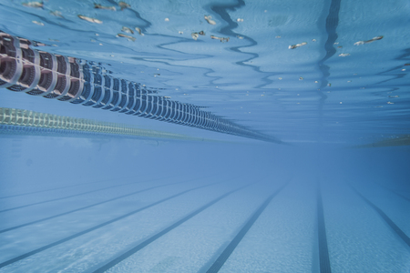 Plastic Swimming Pool Floating Wave-Breaking Lane Line detail from Underwater Stock Photo