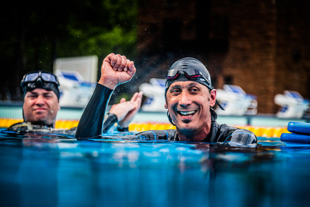 succes: Montreal, CANADA - May 30th, 2015. Official AIDA Freediving Pool Competition Taking place in the Parc Jean-Drapeau Olympic Pool. Happy Freediver Celebrating the Succes of his First Place and record.