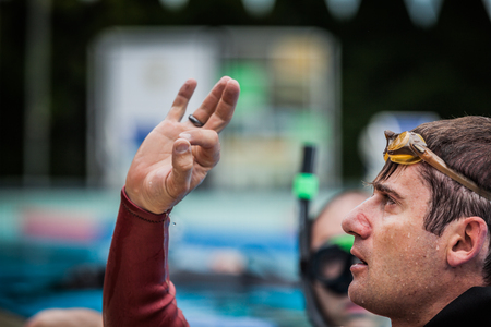 breath hold: Montreal, CANADA - May 30th, 2015. Official AIDA Freediving Pool Competition Taking place in the Aquatic Complex 50m Olympic Pool at Parc Jean-Drapeau. Static Performance Official Protocol.