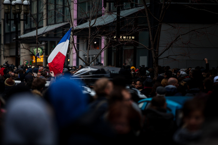 raid: November 14th 2015, Montreal Canada. People Grouping in front of the France consulate in memory of the Jihadists ISIS Terrorist Raid in Paris