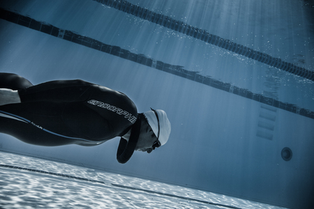freediving: Montreal, CANADA - May 30th, 2015. Official AIDA Freediving Pool Competition Taking place in the Parc Jean-Drapeau Olympic Pool. Dynamic Without Fins (DNF) Performance from Underwater