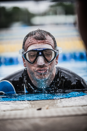 freediving: Montreal, CANADA - May 30th, 2015. Official AIDA Freediving Pool Competition Taking place in the Parc Jean-Drapeau Olympic Pool. Exit of Static Apnea which will be followed with Official Protocol,