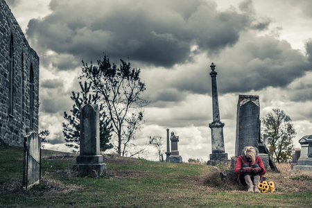 black lady: Lonely Sad Young Woman in Mourning with Sunflowers in front of a Gravestone in a Cemetery