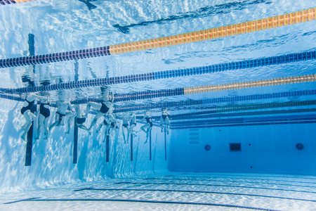 one lane: Underwater view of Unrecognizable Professional Swimmers Training into a 50m Outdoor sports competition Pool Stock Photo