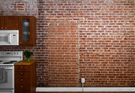 Industrial Old Flat Brick Wall Perspective in a kitchen. Perfect for Painting or Picture Frame Addition Imagens
