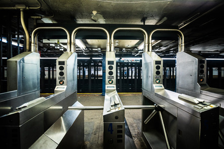 NEW YORK, USA - October 17, 2016. Underground Subway Gates in New York City on line tree.