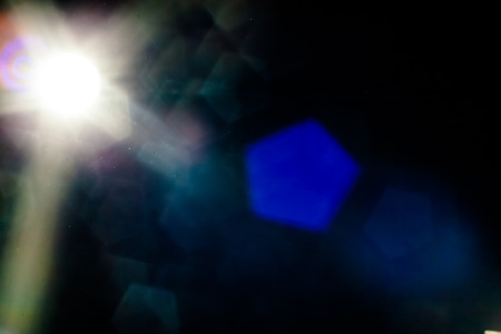 Real Lens Flare Shot in Studio over Black Background. Easy to add as Overlay or Screen Filter over Photos