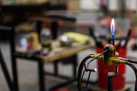 Glassblowing Work Place and Propane Torch Pilot Flame ready to be Used Фото со стока