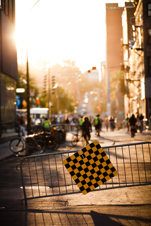 Blocked Street and Fence during Sunset Because of a Festival reserved for Pedestrians.