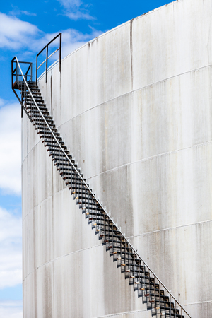 Abstract Detail of a High and Long Stair Case of Abandoned Oil Refinery Stock Photo