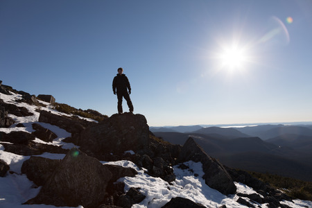 Victorious Man Enjoying the Success of the Richardson Mountain's Summit in Gaspe, Quebec, Canada.
