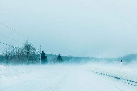 winter road: Crazy Snowstorm and Blowing Snow on the road in Quebec, Canada